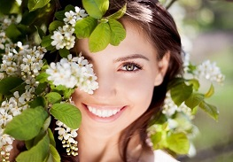 13857862 - beautiful happy brunette woman in the park on a warm summer day