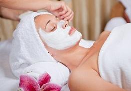 14590817 - skin care, beautician applying face mask cream